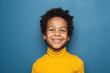 Leinwandbild Motiv Happy child portrait. Little african american kid boy on blue background