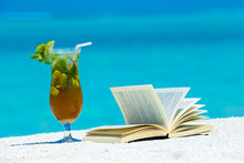 Cocktail And Book On Beach