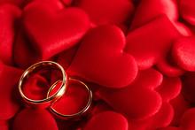 Golden Wedding Rings On Red