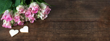 Pink Roses On Rustic Wooden Ta...