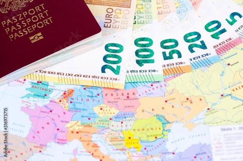 European money with passport on the map background Billede på lærred