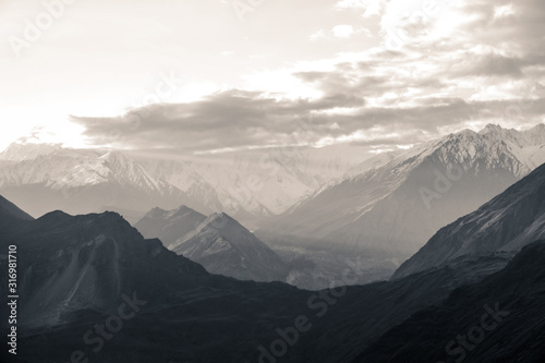 nature-aerial-landscape-view-black-and-white-photo-of-sunrise-over-snow-capped-karakoram-mountain-range-with-morning-fog-in-nagar-valley-gilgit-baltistan-pakistan