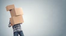 Man Holding Heavy Cardboard Bo...