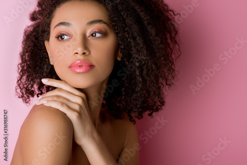 Fototapeta portrait of attractive curly nude african american girl on pink obraz