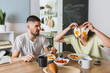 canvas print picture - romantic couple eating breakfast at home
