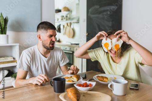 Obraz na plátne romantic couple eating breakfast at home