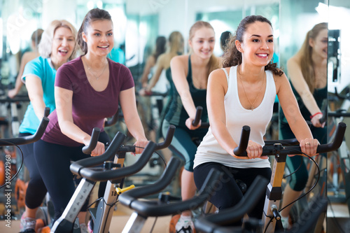 Fotografie, Obraz Females cycling in sport club .
