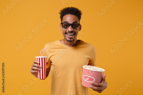 Excited young african american guy in 3d imax glasses posing isolated on yellow orange background фототапет