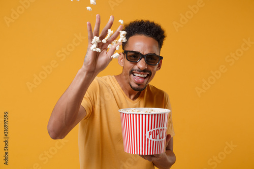 Laughing young african american guy in 3d imax glasses posing isolated on yellow orange background фототапет