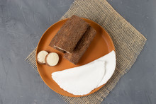 Tapioca, A Traditional Brazilian Snack Made From Cassava Flour. Cassava And Dry Coconut On The Back.
