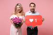 Couple two guy girl in party outfit celebrating isolated on pink background. Valentine's Day, Women's Day, birthday holiday concept. Hold huge like sign from Instagram heart form bouquet of flowers.