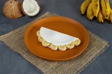 Banana Tapioca, A Tradicional Brazilian Food. Made From Starch Of Cassava. With Banana E Casavas In The Back.  Close Up