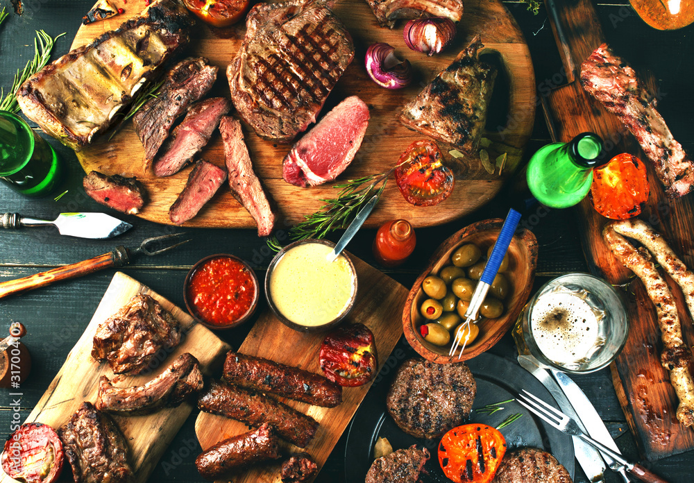 Fototapeta Assorted delicious grilled meat with vegetables