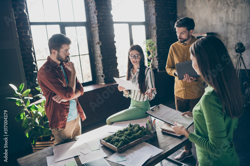 Fototapety, obrazy: Company of four nice attractive busy skilled qualified businesspeople professional IT specialists discussing innovation startup launch at industrial loft interior style workplace workstation office