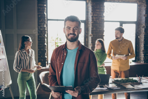 Photo of cheerful toothy bearded man having attended courses at business analysi Canvas Print