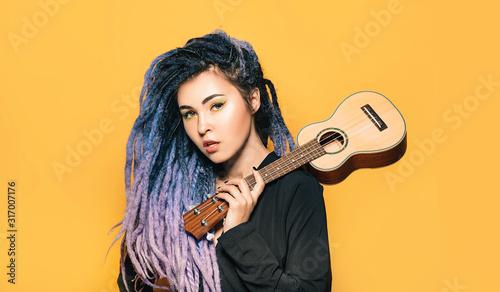 Fototapeta Rastafari woman with ukulele on her shoulder