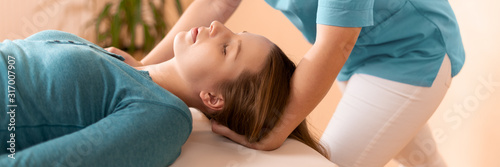 Cuadros en Lienzo Female physiotherapist or a chiropractor adjusting patients neck