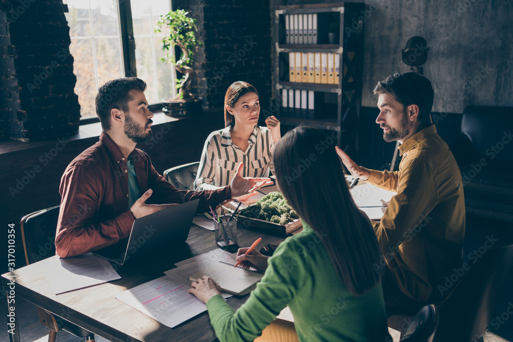 Fototapeta Serious skilled professional experienced businesspeople wearing casual formal-wear discussing contract agreement financial growth at modern industrial loft brick style interior workplace workstation