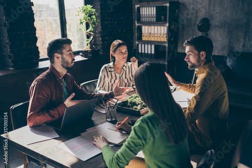 Fototapety, obrazy: Serious skilled professional experienced businesspeople wearing casual formal-wear discussing contract agreement financial growth at modern industrial loft brick style interior workplace workstation