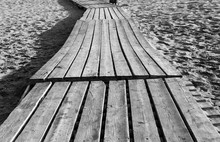 Old Wooden Flooring On A Sandy Beach. Summer Black White Background.