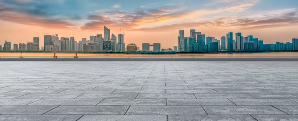Urban skyscrapers with empty square floor tiles