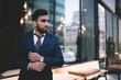 Leinwanddruck Bild - Serious adult ethnic executive man in office building