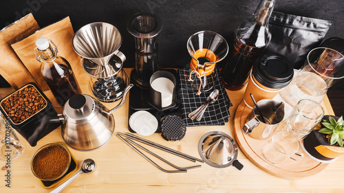 Obraz Accessories and utensils for making coffee using alternative methods, wooden table in the interior of the coffee shop - fototapety do salonu
