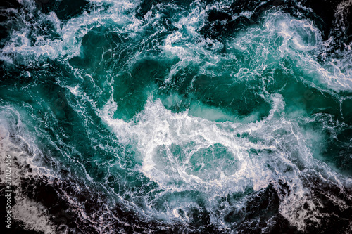 Fototapeta Waves of water of the river and the sea meet each obraz
