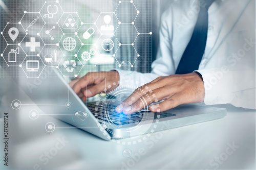Obraz Medical technology and futuristic concept. Doctor hologram modern virtual screen interface. - fototapety do salonu