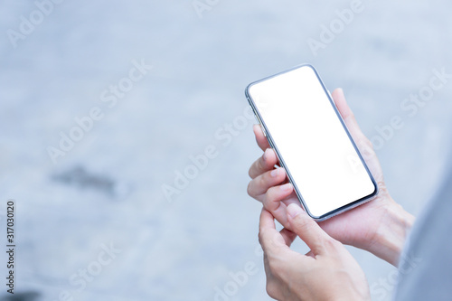 Fototapety, obrazy: Mockup image blank white screen cell phone.woman hand holding texting using mobile.background empty space for advertise text.people contact marketing business,technology