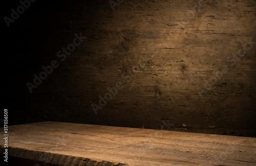 Fototapeta wood brown grain texture, dark wall background, top view of wooden table obraz