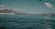 Underwater view of the surf spot with wave breaking over sand bottom. Surfing and sport concept. Filmed on RED 4k, 10 bit color.