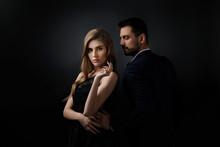 Elegant Couple On Black Backgr...