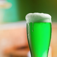 Glass Of Light Green Beer With...