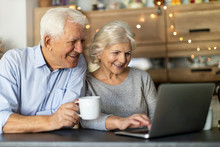 Senior Couple Using Laptop In ...