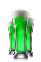 Green Beer In Glasses Isolated...
