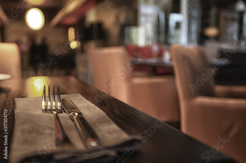 Fototapeta fork and knife serving in the interior of the restaurant / table in a cafe, food industry catering, menu obraz