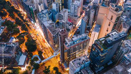 Fotografía Aerial top view of downtown district  buildings in night city light