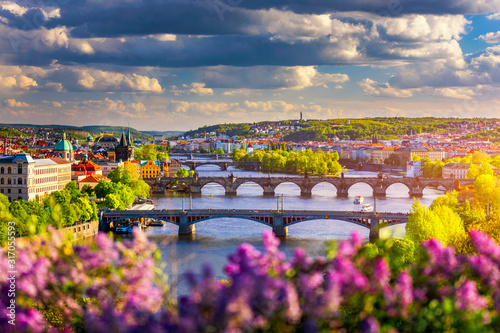 Obraz Scenic view of the Old Town pier architecture and Charles Bridge over Vltava river in Prague, Czech Republic. Prague iconic Charles Bridge (Karluv Most) and Old Town Bridge Tower at sunset, Czechia. - fototapety do salonu