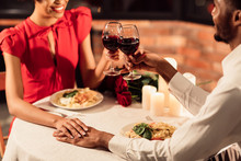Unrecognizable Afro Lovers Clinking Glasses Holding Hands In Restaurant, Cropped