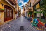 Fototapeta Uliczki - Street in the old town of Chania, Crete, Greece. Charming streets of Greek islands, Crete. Beautiful street in Chania, Crete island, Greece. Summer landscape. Chania old street of Crete island Greece.