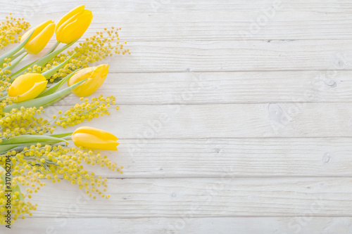 tulips and mimosa on white wooden background Fototapete