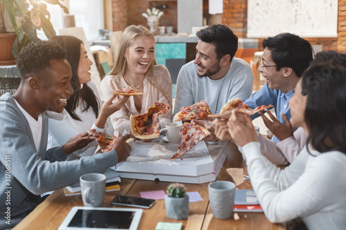 Happy people eating pizza at office during lunch time Wallpaper Mural