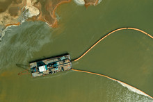 A Dredger Working In The Quarry For Sand Mining. Aerial View