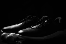 Golf Shoes On Isolated Black Background.