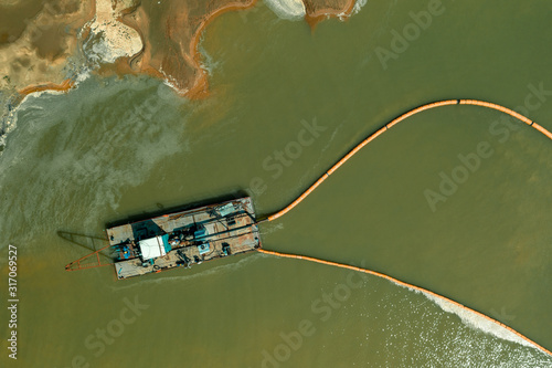 Valokuva A dredger working in the quarry for sand mining. Aerial view