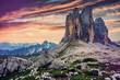 Wonderful nature landscape. Scenik image of Tre cime di Lavaredo national park. View on a Famouse Tre peaks Di Lavaredo during sunset. Epic dramatic scene with colorful sky. Amazing nature scenery.