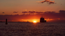 Cargo Ship In The Baltic Sea At Sunset. Latvia