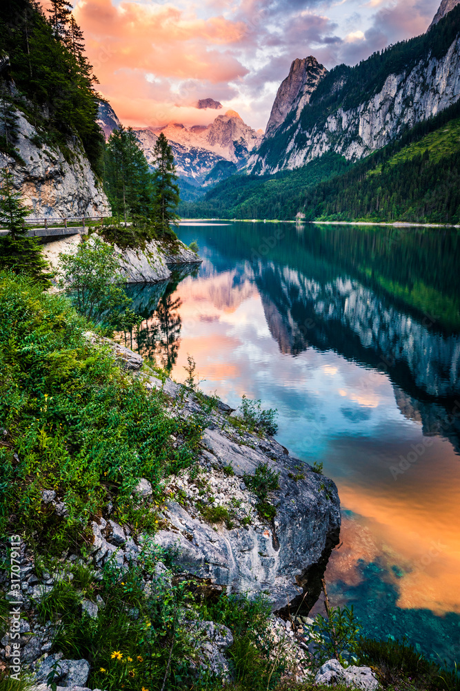 Fototapeta Gosausee lake in sunset, Dachstein with clouds