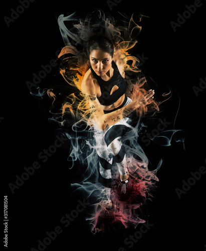 Sporty young woman running on smoke background Wallpaper Mural